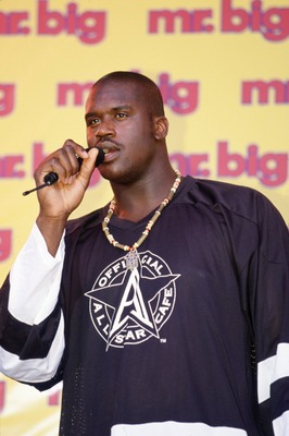 25 Oct 1995:  Shaquille O''Neal of the Orlando Magic raps during the presentation of his new candy bar 'Mr. Big' at Walt Disneyworld in Orlando, Florida.  Mandatory Credit: Andy Lyons/ALLSPORT