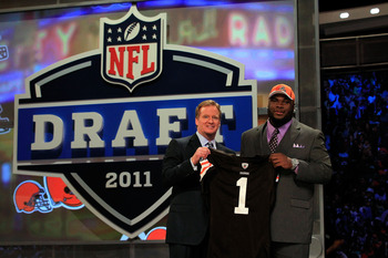 NEW YORK, NY - APRIL 28:  NFL Commissioner ROger Goodell (L) poses for a photo with Phil Taylor, #21 overall pick by the Cleveland Browns, on stage during the 2011 NFL Draft at Radio City Music Hall on April 28, 2011 in New York City.  (Photo by Chris Tro