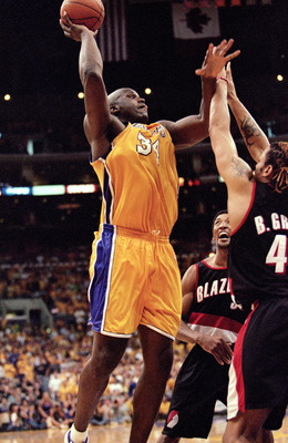 LOS ANGELES - JUNE 4:  Shaquille O'Neal #34 of the Los Angeles Lakers shoots over Brian Grant #44 of the Portland Trail Blazers during Game 7 of the Western Conference Finals at Staples Center on June 4, 2000 in Los Angeles, California. The Lakers won 98-