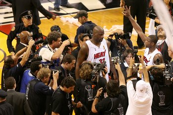 MIAMI - JUNE 18:  Shaquille O'Neal #32 and Dwyane Wade #3 of the Miami Heat are surrounded by the media after their overtime victory over the Dallas Mavericks in game five of the 2006 NBA Finals on June 18, 2006 at American Airlines Arena in Miami, Florid