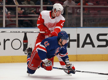 NEW YORK - SEPTEMBER 29: Brendan Smith #2 of the Detroit Red Wings hits Artem Anisimov #42 of the New York Rangers at Madison Square Garden on September 29, 2010 in New York City. (Photo by Bruce Bennett/Getty Images)