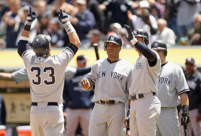 OAKLAND, CA - JUNE 01:  Nick Swisher #33 of the New York Yankees is congratulated by Robinson Cano #24 and Alex Rodriguez #13 after he hit a three run home run in the fourth inning against the Oakland Athletics at Oakland-Alameda County Coliseum on June 1