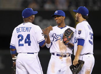 KANSAS CITY, MO - MAY 31:  Alcides Escobar #2 of the Kansas City Royals is congratulates Wilson Betemit #24 and Eric Hosmer #35 after the Royals defeated the Los Angeles Angels of Anaheim on May 31, 2011 at Kauffman Stadium in Kansas City, Missouri.  (Pho