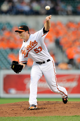 BALTIMORE, MD - MAY 18:  Zach Britton #53 of the Baltimore Orioles pitches against the New York Yankees at Oriole Park at Camden Yards on May 18, 2011 in Baltimore, Maryland.  (Photo by Greg Fiume/Getty Images)
