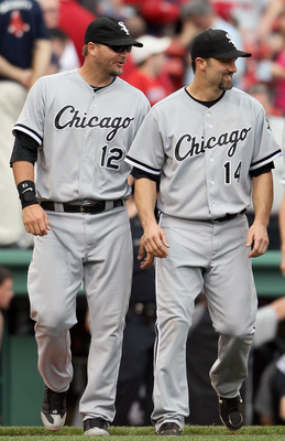 BOSTON, MA - JUNE 01:  A.J. Pierzynski #12 and Paul Konerko #14 of the Chicago White Sox celebrate the win over the Boston Red Sox on June 1, 2011 at Fenway Park in Boston, Massachusetts. The Chicago White Sox defeated the Boston Red Sox 7-4.  (Photo by E
