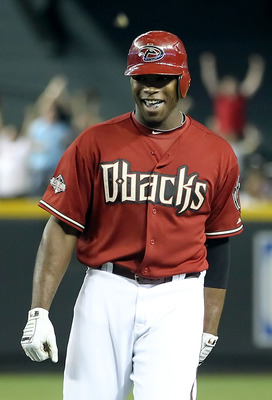 PHOENIX, AZ - JUNE 01:  Justin Upton #10 of the Arizona Diamondbacks celebrates after his game winning RBI single against the Florida Marlins in ninth inning of the Major League Baseball game at Chase Field on June 1, 2011 in Phoenix, Arizona. The Diamond