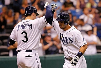 ST. PETERSBURG, FL - MAY 31:  Infielder Evan Longoria #3 of the Tampa Bay Rays congratulates infielder Sean Rodriguez #1 after his home run against the Texas Rangers during the game at Tropicana Field on May 31, 2011 in St. Petersburg, Florida.  (Photo by