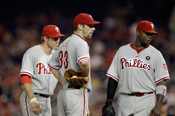 WASHINGTON, DC - MAY 31:  Second baseman Chase Utley #26 of the Philadelphia Phillies (L) talks with pitcher Cliff Lee #33 (C) and first baseman Ryan Howard #6 (R) during a pitching change against the Washington Nationals at Nationals Park on May 31, 2011