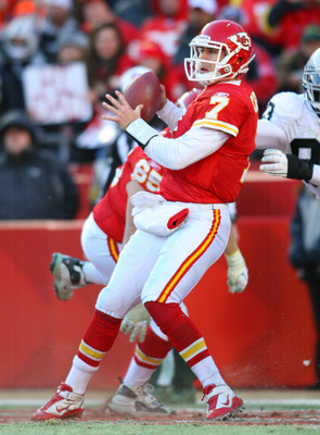 KANSAS CITY, MO - JANUARY 02:  Quarterback Matt Cassel #7 of the Kansas City Chiefs is hit as he throws by defensive tackle Tommy Kelly #93 of the Oakland Raiders in a game at Arrowhead Stadium on January 2, 2011 in Kansas City, Missouri.  (Photo by Tim U