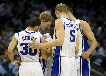 CHARLOTTE, NC - MARCH 20:  The Duke Blue Devils huddle before taking on the Michigan Wolverines during the third round of the 2011 NCAA men's basketball tournament at Time Warner Cable Arena on March 20, 2011 in Charlotte, North Carolina.  (Photo by Stree