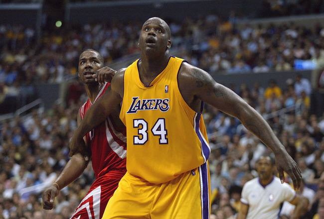 LOS ANGELES - APRIL 28:  Shaquille O'Neal #34 of the Los Angeles Lakers boxes out Kelvin Cato #13 of the Houston Rockets during Game five of the Western Conference Quarterfinals during the 2004 NBA Playoffs at Staples Center on April 28, 2004 in Los Angel