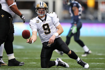 SEATTLE, WA - JANUARY 08:  Drew Brees #9 of the New Orleans Saints gets up after a play against the Seattle Seahawks during the 2011 NFC wild-card playoff game at Qwest Field on January 8, 2011 in Seattle, Washington.  (Photo by Otto Greule Jr/Getty Image