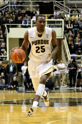 WEST LAFAYETTE, IN - JANUARY 09:  JaJuan Johnson #25 of the Purdue Boilermakers drives against the Iowa Hawkeyes at Mackey Arena on January 9, 2011 in West Lafayette, Indiana. Purdue won 75-52.  (Photo by Chris Chambers/Getty Images)