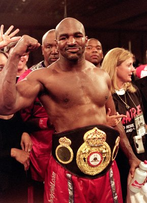 12 Aug 2000: Evander Holyfield celebrates in the ring as he wears the Heavyweight belt after a WBA Heavyweight Championship fight against John Ruiz at the Paris Hotel and Casino in Las Vegas, Nevada. Holyfield defeated Ruiz by a decison in the 12th round.