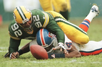 8 Dec 1996:  Defensive end Reggie White #92 of the Green Bay Packers scrambles over wide receiver Shannon Sharpe #84 of the Denver Broncos for quarterback Bill Musgrave''s fumble in the fourth quarter of their game at Lambeau Field in Green Bay, Wisconsin