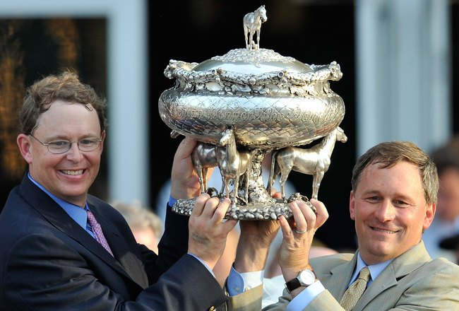 ELMONT, NY - JUNE 05:  Elliott Walden, Racing manager for WinStar Farms and trainer Bill Mott on the right hoist the Belmont trophy after their horse Drosselmeyer won the142nd Belmont Stakes at Belmont Park on June 5, 2010 in Elmont, New York.  (Photo by