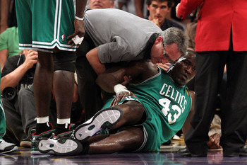 LOS ANGELES, CA - JUNE 15:  Kendrick Perkins #43 of the Boston Celtics goes down with an injury in the first quarter against the Los Angeles Lakers in Game Six of the 2010 NBA Finals on June 15, 2010 at Staples Center in Los Angeles, California. NOTE TO U