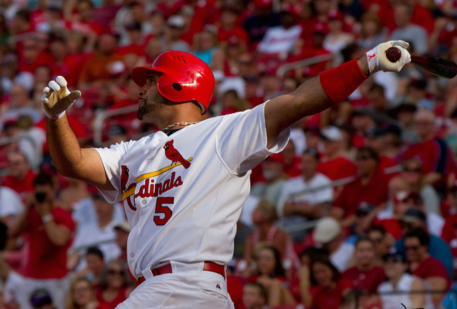 ST. LOUIS, MO - MAY 30: Albert Pujols #5 of the St. Louis Cardinals hits a solo home run against the San Francisco Giants at Busch Stadium on May 30, 2011 in St. Louis, Missouri.  (Photo by Dilip Vishwanat/Getty Images)