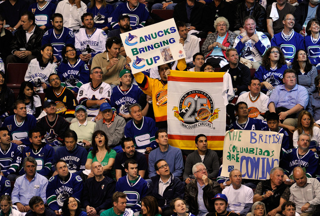 VANCOUVER, BC - JUNE 01:  Fans of the  Vancouver Canucks cheer during game one against the Boston Bruins in the 2011 NHL Stanley Cup Finals at Rogers Arena on June 1, 2011 in Vancouver, Canada.  (Photo by Rich Lam/Getty Images)