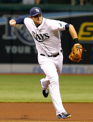 ST. PETERSBURG, FL - MAY 16:  Infielder Evan Longoria #3 of the Tampa Bay Rays throws over to first for an out against the New York Yankees during the game at Tropicana Field on May 16, 2011 in St. Petersburg, Florida.  (Photo by J. Meric/Getty Images)