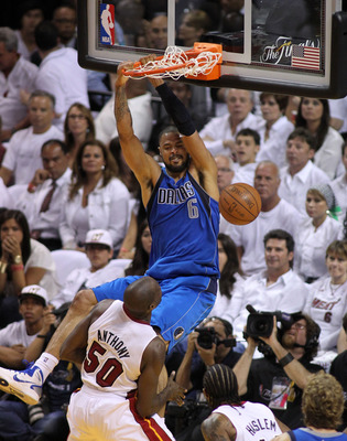 MIAMI, FL - MAY 31:  Tyson Chandler #6 of the Dallas Mavericks dunks the ball against Joel Anthony #50 of the Miami Heat in the first half in Game One of the 2011 NBA Finals at American Airlines Arena on May 31, 2011 in Miami, Florida. NOTE TO USER: User