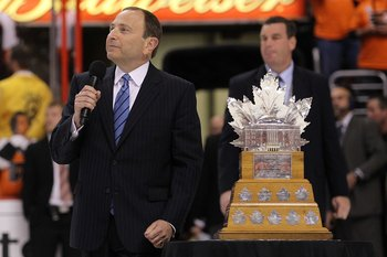 PHILADELPHIA - JUNE 09:  NHL Commissioner Gary Bettman presents the Conn Smythe Trophy to Jonathan Toews #19 of the Chicago Blackhawks after the Blackhawks defeated the Philadelphia Flyers 4-3 in overtime to win the Stanley Cup in Game Six of the 2010 NHL