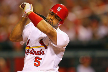 ST. LOUIS, MO - JUNE 1: Albert Pujols #5 of the St. Louis Cardinals dodges an inside pitch against the San Francisco Giants at Busch Stadium on June 1, 2011 in St. Louis, Missouri.  (Photo by Dilip Vishwanat/Getty Images)