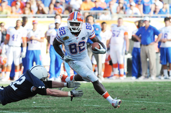 TAMPA, FL - JANUARY 1:  Wide receiver Omarius Hines #82 of the Florida Gators rushes upfield against the Penn State Nittany Lions January 1, 2010 in the 25th Outback Bowl at Raymond James Stadium in Tampa, Florida.  (Photo by Al Messerschmidt/Getty Images