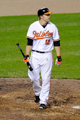 BALTIMORE, MD - MAY 19:  Mark Reynolds #12 of the Baltimore Orioles walks to the dugout after striking out against the New York Yankees at Oriole Park at Camden Yards on May 19, 2011 in Baltimore, Maryland.  (Photo by Greg Fiume/Getty Images)