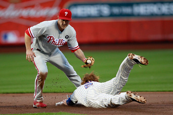 NEW YORK, NY - MAY 28: Justin Turner #2 of the New York Mets steals second base in front of Chase Utley #26 of the Philadelphia Phillies at Citi Field on May 28, 2011 in the Flushing neighborhood of the Queens borough of New York City.  (Photo by Chris Tr