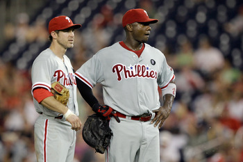 WASHINGTON, DC - MAY 31: Chase Utley #26 of the Philadelphia Phillies and Ryan Howard #6 talk between innings against the Washington Nationals  at Nationals Park on May 31, 2011 in Washington, DC. The Braves won 2-0. (Photo by Rob Carr/Getty Images)