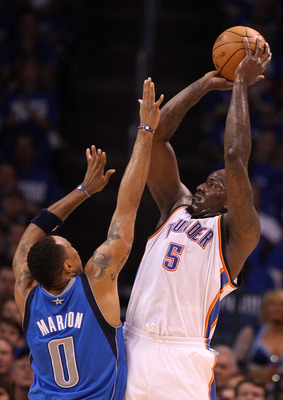 OKLAHOMA CITY, OK - MAY 21:  Kendrick Perkins #5 of the Oklahoma City Thunder shoots over Shawn Marion #0 of the Dallas Mavericks in the first quarter in Game Three of the Western Conference Finals during the 2011 NBA Playoffs at Oklahoma City Arena on Ma