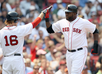 BOSTON, MA - JUNE 01:  David Ortiz #34 of the Boston Red Sox is congratulated by teammate Josh Reddick #16 after Ortiz scored in the second inning against the Chicago White Sox on June 1, 2011 at Fenway Park in Boston, Massachusetts.  (Photo by Elsa/Getty