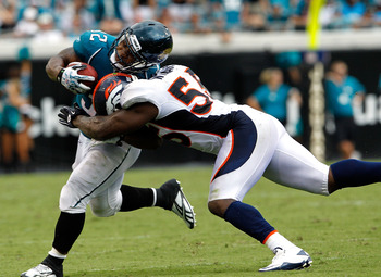 JACKSONVILLE, FL - SEPTEMBER 12:  D.J. Williams #55 of the Denver Broncos attempts to tackle Maurice Jones-Drew #32 of the Jacksonville Jaguars during the NFL season opener game at EverBank Field on September 12, 2010 in Jacksonville, Florida.  (Photo by