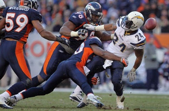 DENVER - JANUARY 02:  Running back Ryan Mathews #24 of the San Diego Chargers fumbles the ball as he is tackled by Brian Dawkins #20 of the Denver Broncos at INVESCO Field at Mile High on January 2, 2011 in Denver, Colorado. The ball was recovered by Kris