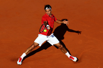 PARIS, FRANCE - MAY 31:  Roger Federer of Switzerland hits a forehand during the men's singles quarterfinal match between Gael Monfils of France and Roger Federer of Switzerland on day ten of the French Open at Roland Garros on May 31, 2011 in Paris, Fran
