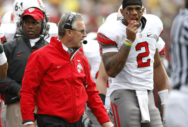 ANN ARBOR, MI - NOVEMBER 21: Head coach Jim Tressel of the Ohio State Buckeyes walks the sideline next to Terrelle Pryor #2 while playing the Michigan Wolverines on November 21, 2009 at Michigan Stadium in Ann Arbor, Michigan. Ohio State won the game 21-1