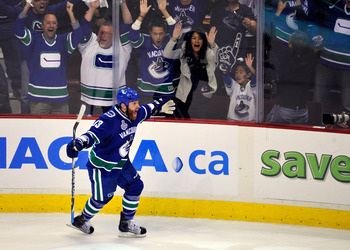 VANCOUVER, BC - JUNE 01:  Raffi Torres #13 of the Vancouver Canucks celebrates after scoring a goal late in the third period against Tim Thomas #30 of the Boston Bruins during game one of the 2011 NHL Stanley Cup Finals at Rogers Arena on June 1, 2011 in
