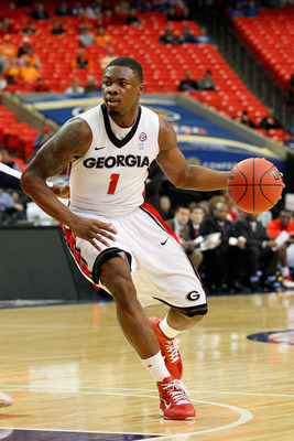 ATLANTA, GA - MARCH 10:  Travis Leslie #1 of the Georgia Bulldogs drives against the Auburn Tigers during the the first round of the SEC Men's Basketball Tournament at the Georgia Dome on March 10, 2011 in Atlanta, Georgia.  (Photo by Kevin C. Cox/Getty I