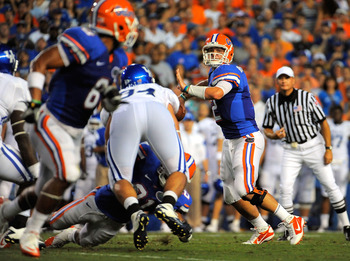 GAINESVILLE, FL - SEPTEMBER 25:  Quarterback John Brantley #12 of the Florida Gators looks to throw against the Kentucky Wildcats at Ben Hill Griffin Stadium on September 25, 2010 in Gainesville, Florida.  (Photo by Doug Benc/Getty Images)