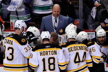VANCOUVER, BC - JUNE 01:  Head Coach Claude Julien (C) of the Boston Bruins speaks to the player on the bench after a play against the Vancouver Canucks in game one of the 2011 NHL Stanley Cup Finals at Rogers Arena on June 1, 2011 in Vancouver, Canada.