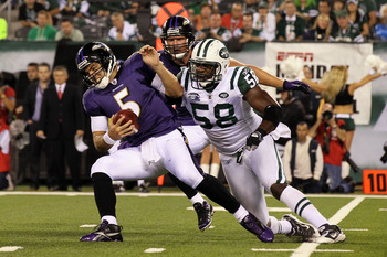EAST RUTHERFORD, NJ - SEPTEMBER 13: Joe Flacco #5 of the Baltimore Ravens gets sacked by Bryan Thomas #58 of the New York Jets during their home opener at the New Meadowlands Stadium on September 13, 2010 in East Rutherford, New Jersey.  (Photo by Jim McI