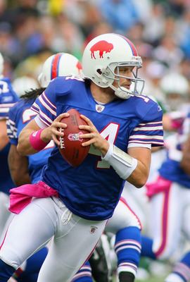 ORCHARD PARK, NY - OCTOBER 03:  Ryan Fitzpatrick #14 of the Buffalo Bills rolls out to pass against the New York Jets  at Ralph Wilson Stadium on October 3, 2010 in Orchard Park, New York. The Jets won 38-14.  (Photo by Rick Stewart/Getty Images)