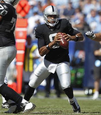 NASHVILLE - SEPTEMBER 12: Jason Campbell #8 of the Oakland Raiders looks to pass against the Tennessee Titans during the NFL season opener at LP Field on September 12, 2010 in Nashville, Tennessee. The Titans defeated the Raiders 38-13. (Photo by Joe Robb