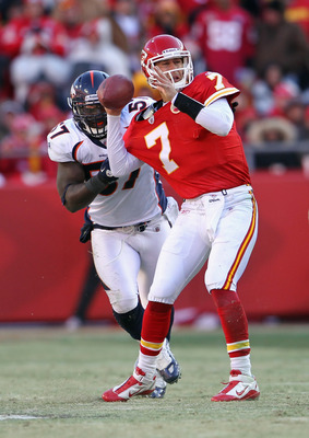 KANSAS CITY, MO - DECEMBER 05:  Quarterback Matt Cassel #7 of the Kansas City Chiefs is pressured by Mario Haggan #57 of the Denver Broncos during the game on December 5, 2010 at Arrowhead Stadium in Kansas City, Missouri.  (Photo by Jamie Squire/Getty Im
