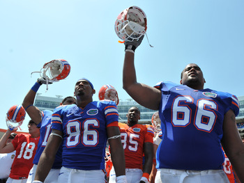 GAINESVILLE, FL - APRIL 9:  Tight end Josh Postell #86 and guard James Wilson #66 of the Florida Gators celebrate after the Orange and Blue spring football game April 9, 2011 Ben Hill Griffin Stadium at Gainesville, Florida.  (Photo by Al Messerschmidt/Ge