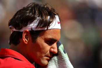 PARIS, FRANCE - MAY 31:  Roger Federer of Switzerland reacts during the men's singles quarterfinal match between Gael Monfils of France and Roger Federer of Switzerland on day ten of the French Open at Roland Garros on May 31, 2011 in Paris, France.  (Pho