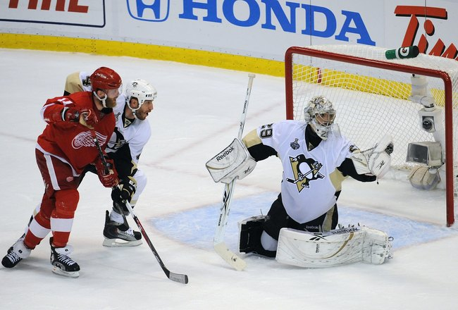 DETROIT - JUNE 12:  Goaltender Marc-Andre Fleury #29 of the Pittsburgh Penguins makes a glove save against the Detroit Red Wings during Game Seven of the 2009 NHL Stanley Cup Finals at Joe Louis Arena on June 12, 2009 in Detroit, Michigan. The Penguins de
