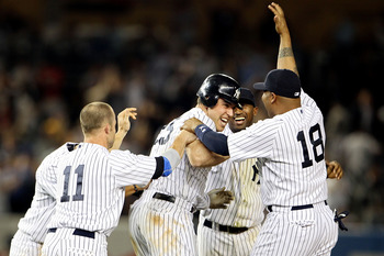 NEW YORK, NY - MAY 24:  Mark Teixeira #25 of the New York Yankees celebrates with Brett Gardner #11 and Andruw Jones #18 after hitting a game winning RBI in the ninth inning against the Toronto Blue Jays at Yankee Stadium on May 24, 2011 in the Bronx boro