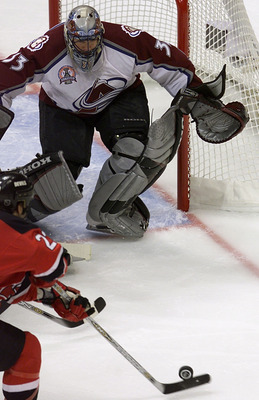 9 Jun 2001:   Goalie Patrick Roy #33 of the Colorado Avalanche prepares to make a save against Scott Gomez #23 of the New Jersey Devils during Game 7 of the Stanley Cup Finals at the Pepsi Center in Denver, Colorado.  The Avalanche won 3-1 to take the Sta
